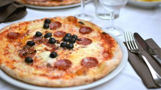 Mangiare pizza per dimagrire, una nuova ricerca lo consiglia