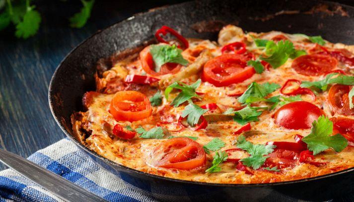 Uova ai peperoni e pomodoro