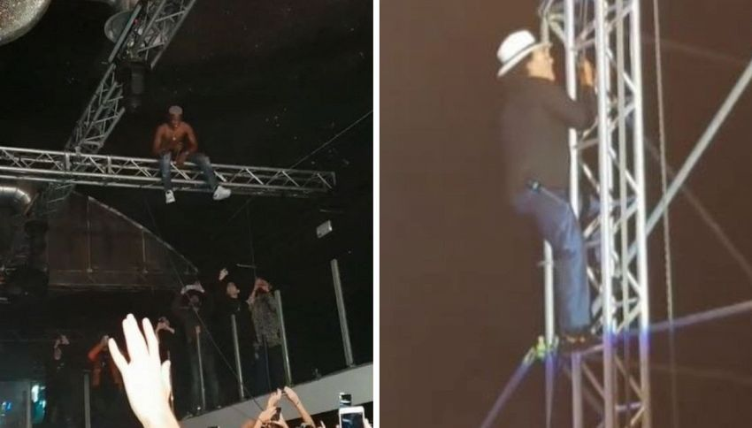 Albano come MHD: si arrampica sull'impalcatura al concerto