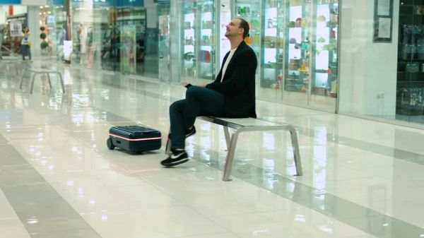This Futuristic Robot Suitcase Moves On Its Own and Follows You